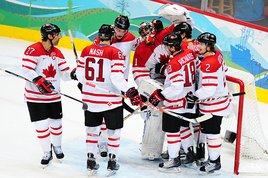 Canada celebrates after defeating Slovakia in their semifinal game at Canada Hockey Place. (United Press International)