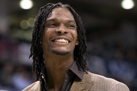 Toronto Raptors' Chris Bosh smiling during the second half of an NBA basketball game against the New York Knicks, in Toronto. (Photo: Associated Press)