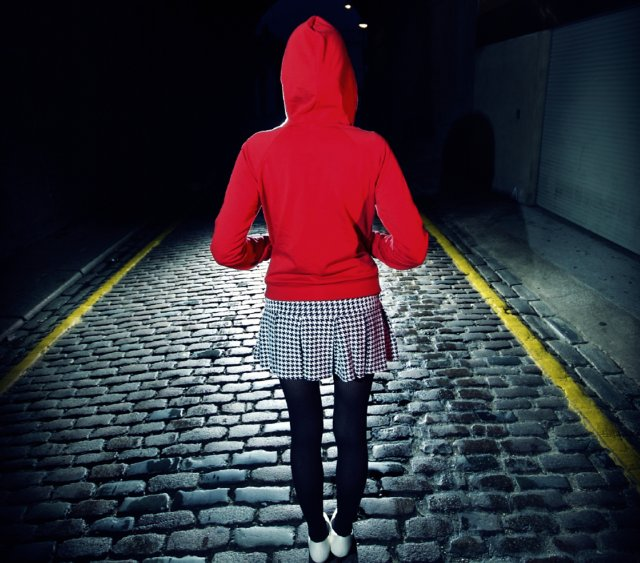 Girl in hoodie in tunnel