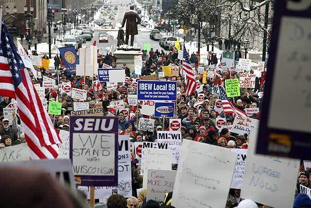 Thousands gather in Michigan to protest controversial right-to-work legislation.
