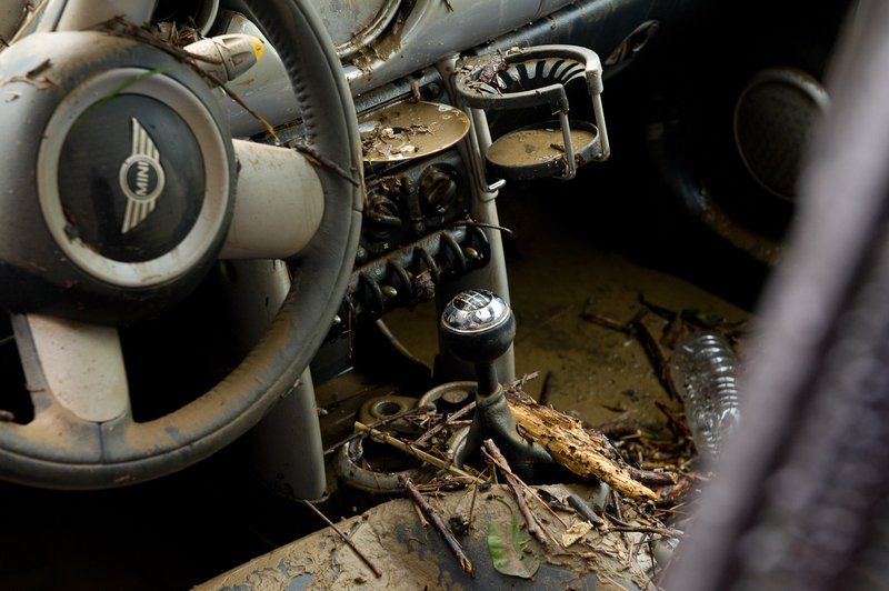 The muddy interior of a Mini Cooper is seen in the parking lot of a Courtyard Marriott hotel on Eisenhower Avenue in Alexandria, Va., on Sept. 9, 2011. The lot was flooded after heavy rains pounded the region the previous night. (Andrew Harnik/The Washington Times)
