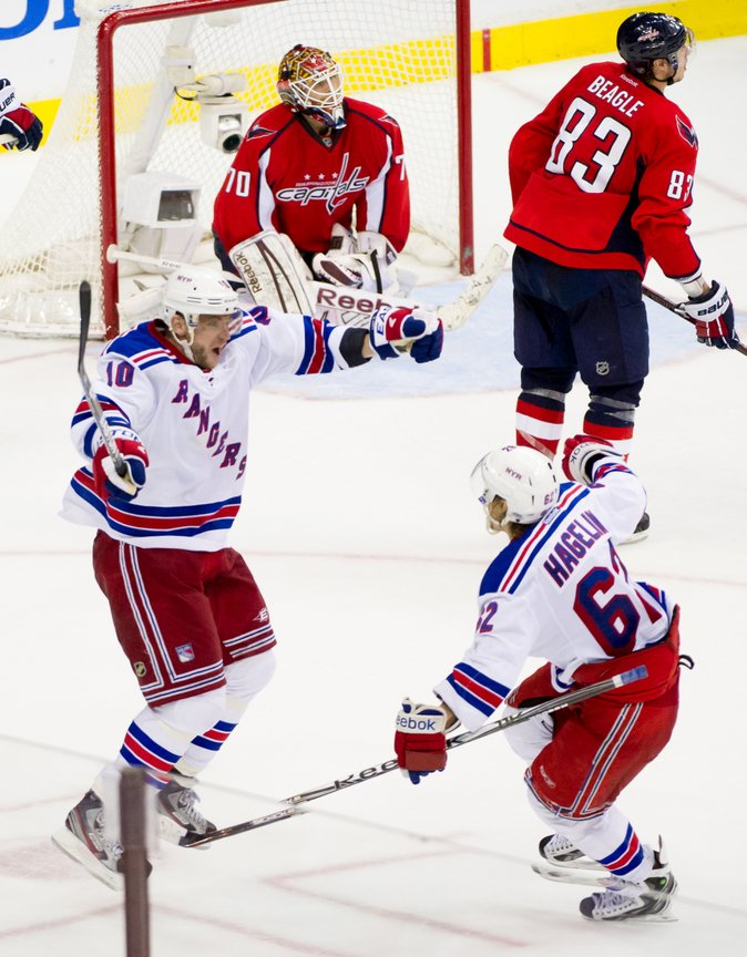 New York Rangers right wing Marian Gaborik (10), left, celebrates with teammate New York Rangers left wing Carl Hagelin (62), right,  as he scores on Washington Capitals goalie Braden Holtby (70), top, in the third overtime period as the Washington Capitals lose to the New York Rangers, 2-1, in playoff NHL hockey at the Verizon Center, Washington, D.C., Thursday, May 3, 2012. (Andrew Harnik/The Washington Times)