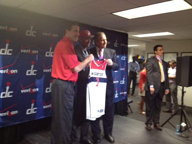 Bradley Beal poses for photographs with Washington Wizards coach Randy Wittman (left) and team president Ernie Grunfeld (right).  (Nicolas Nightingale/The Washington Times)