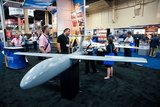 Attendees of the Association for Unmanned Vehicle Systems International, North America 2012, conference check out one of the exhibits displayed inside the exhibition hall of the Mandalay Bay hotel-casino in Las Vegas, Nev., on Tuesday, Aug. 7, 2012. (Martin S. Fuentes/Special to The Washington Times)