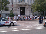 A group of young people gather outside the John A. Wilson Building to protest for more gun rights on Friday. (Tom Howell Jr./The Washington Times)