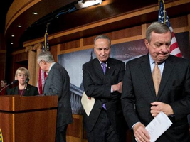 Senate Majority Whip Sen. Richard J. Durbin (above right) leads Sen. Charles E. Schumer, Senate Majority Leader Harry Reid and Sen. Patty Murray out of a news conference after announcing that last-ditch efforts to avert spending cuts had failed. (Associated Press)