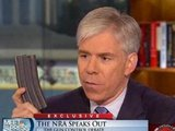 David Gregory holding a 30-round magazine at NBC's Washington bureau (NBC/Meet the Press)
