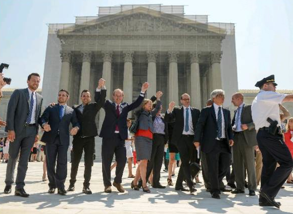 Plaintiffs and supporters for the California Proposition 8 case hail Supreme Court decisions that struck down a section of federal law denying benefits to married gay couples and cleared the way to resume same-sex marriage in California. (An