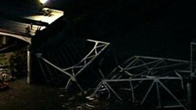 Officials: Truck Hit Bridge Before Collapse