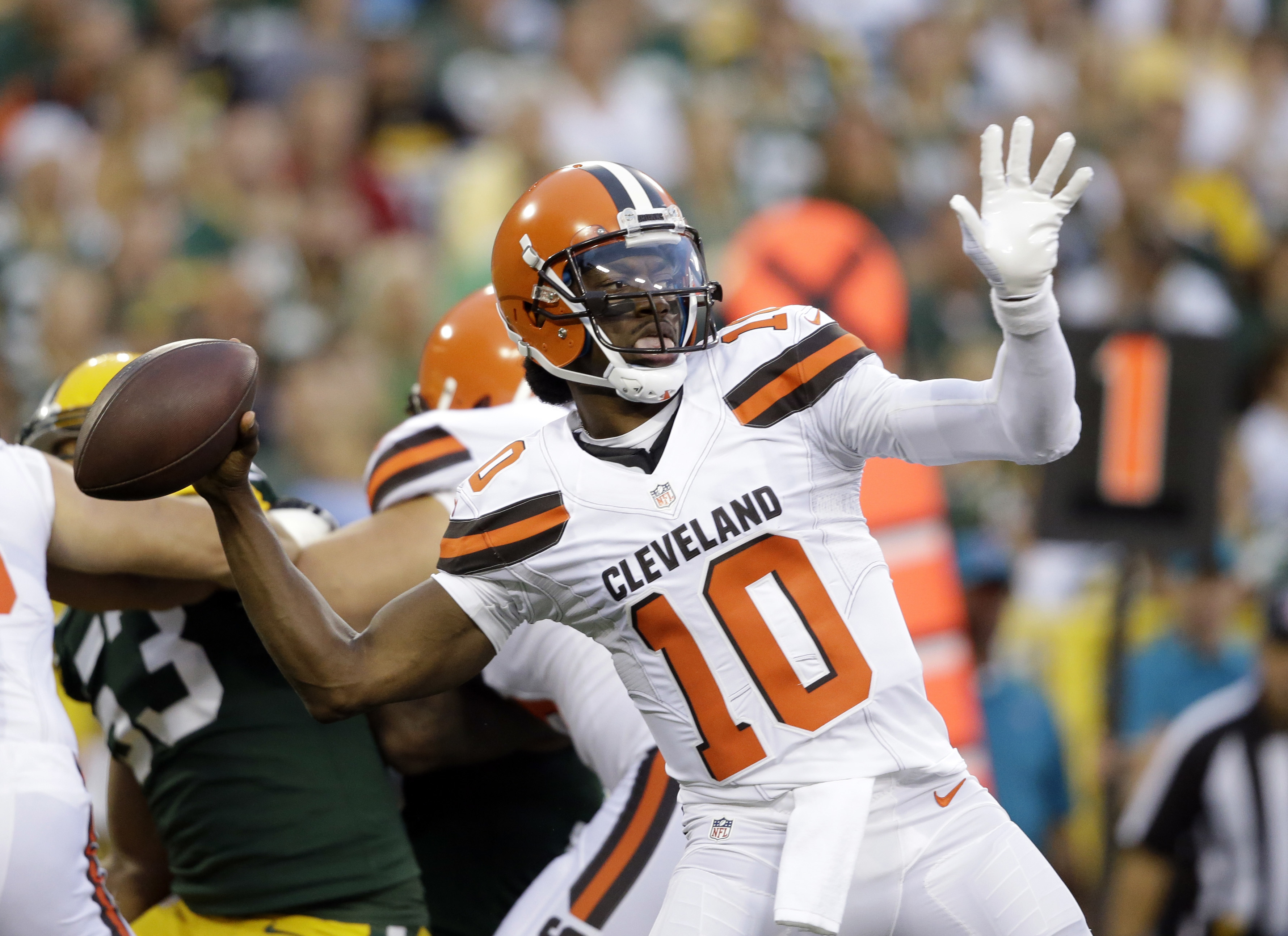 Robert Griffin III completes a long pass, throws interception in ...