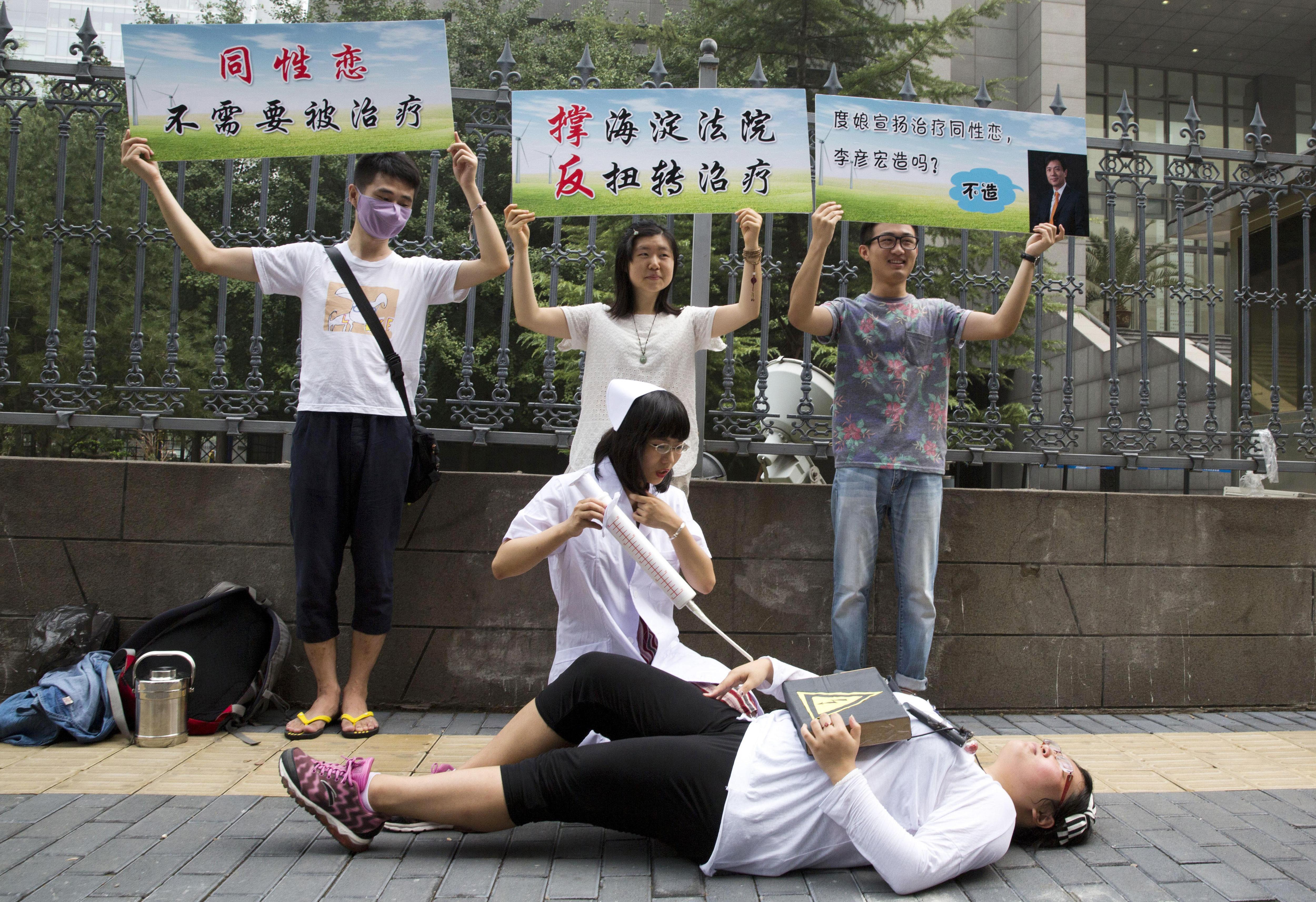 photo image Rights report urges China to ban gay conversion therapy