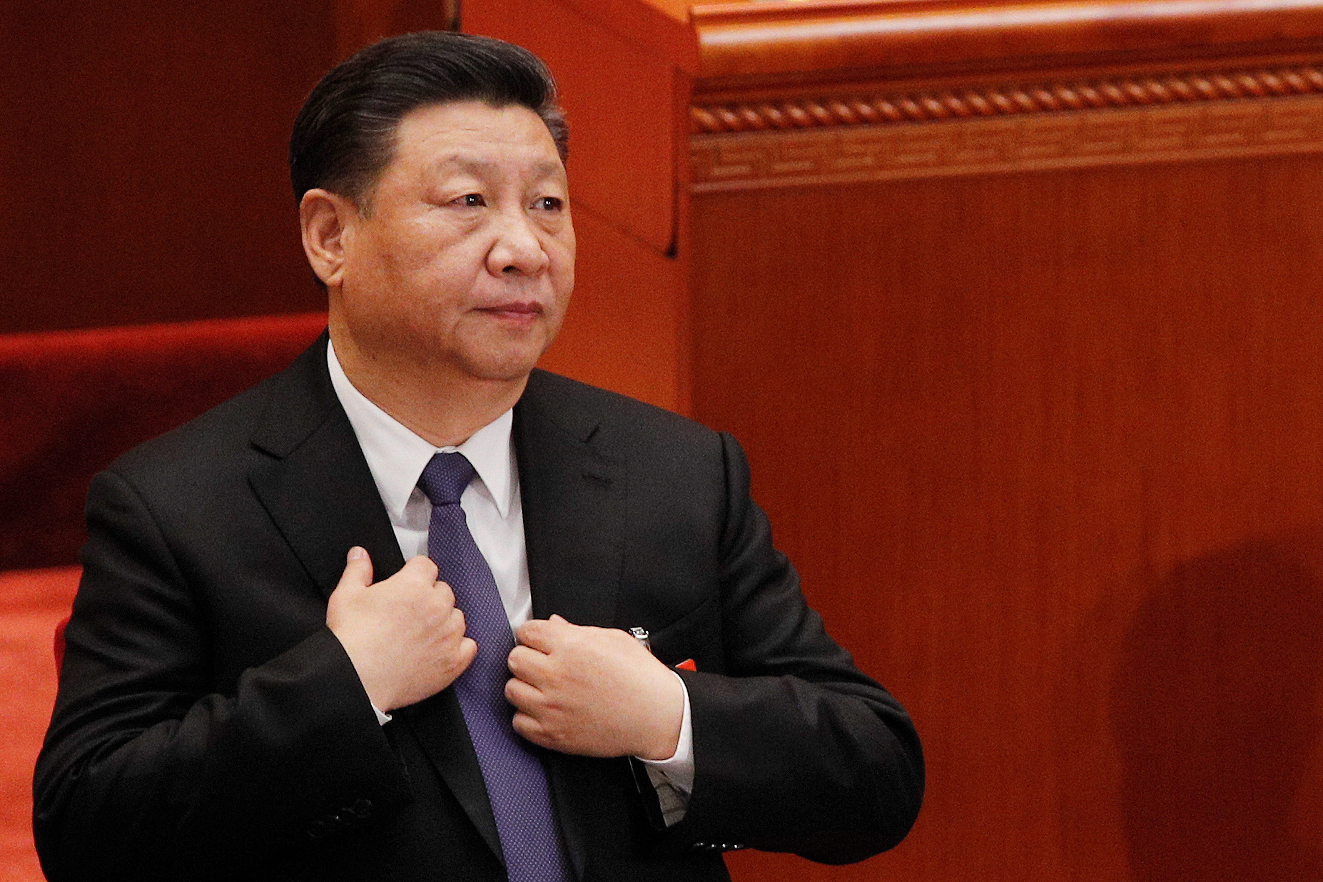 Xi Jinping's corruption crackdown in China cements grip on power, changes look of Beijing