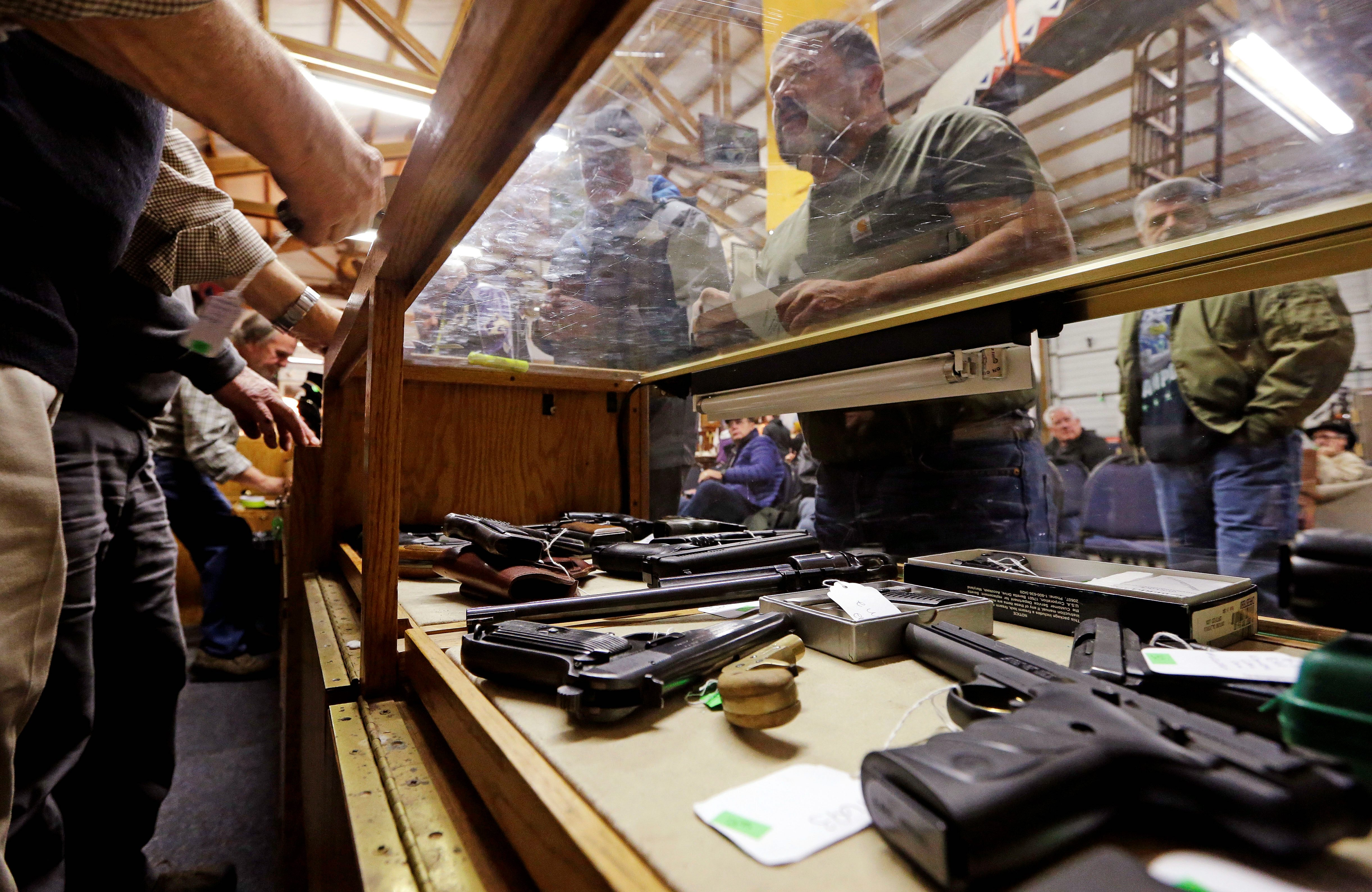 Federal gun background checks fall to lowest monthly level in four years