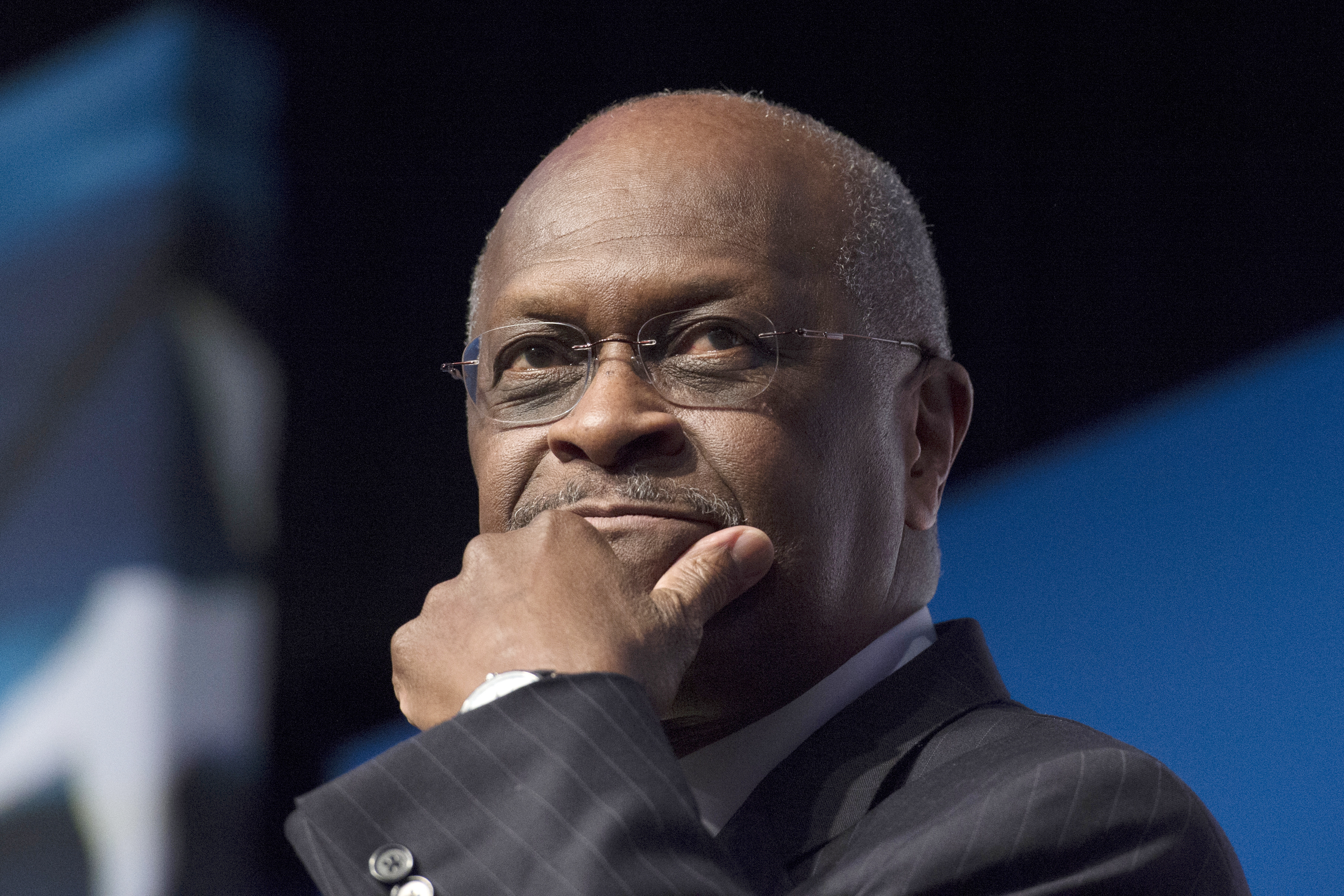 Herman Cain: Half of blacks 'brainwashed' by media into hating Donald Trump