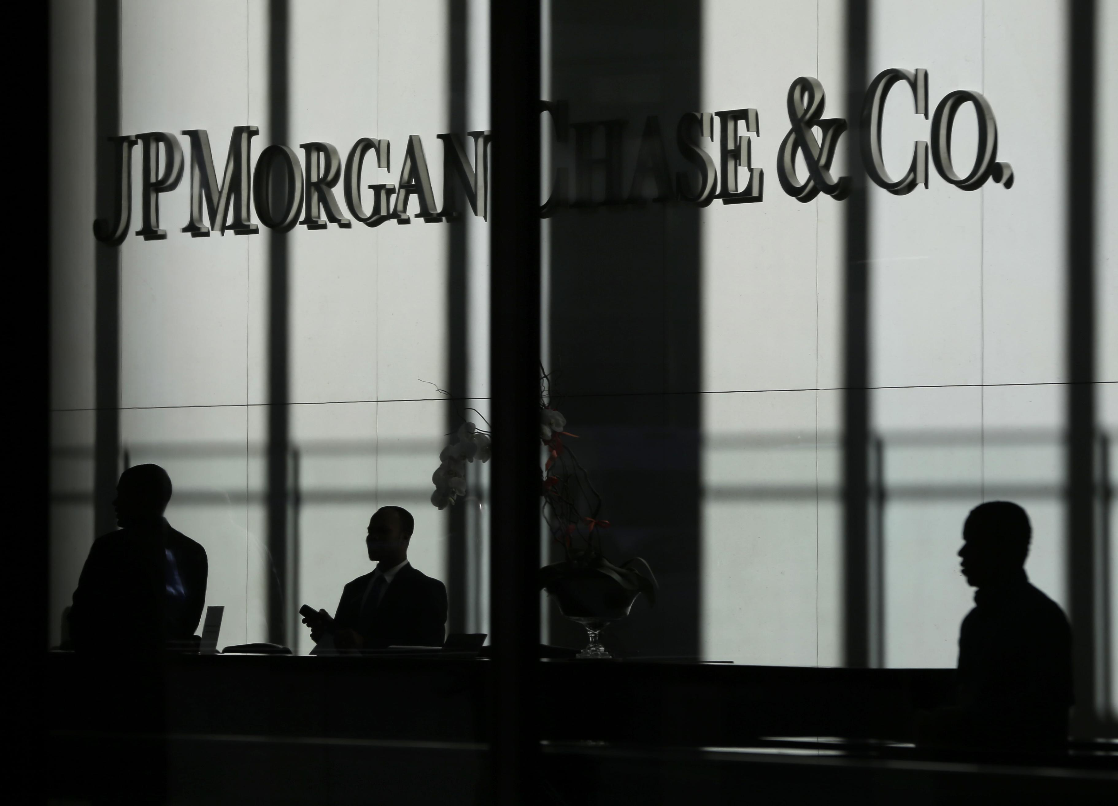 Justice Department charges three JPMorgan traders with market manipula