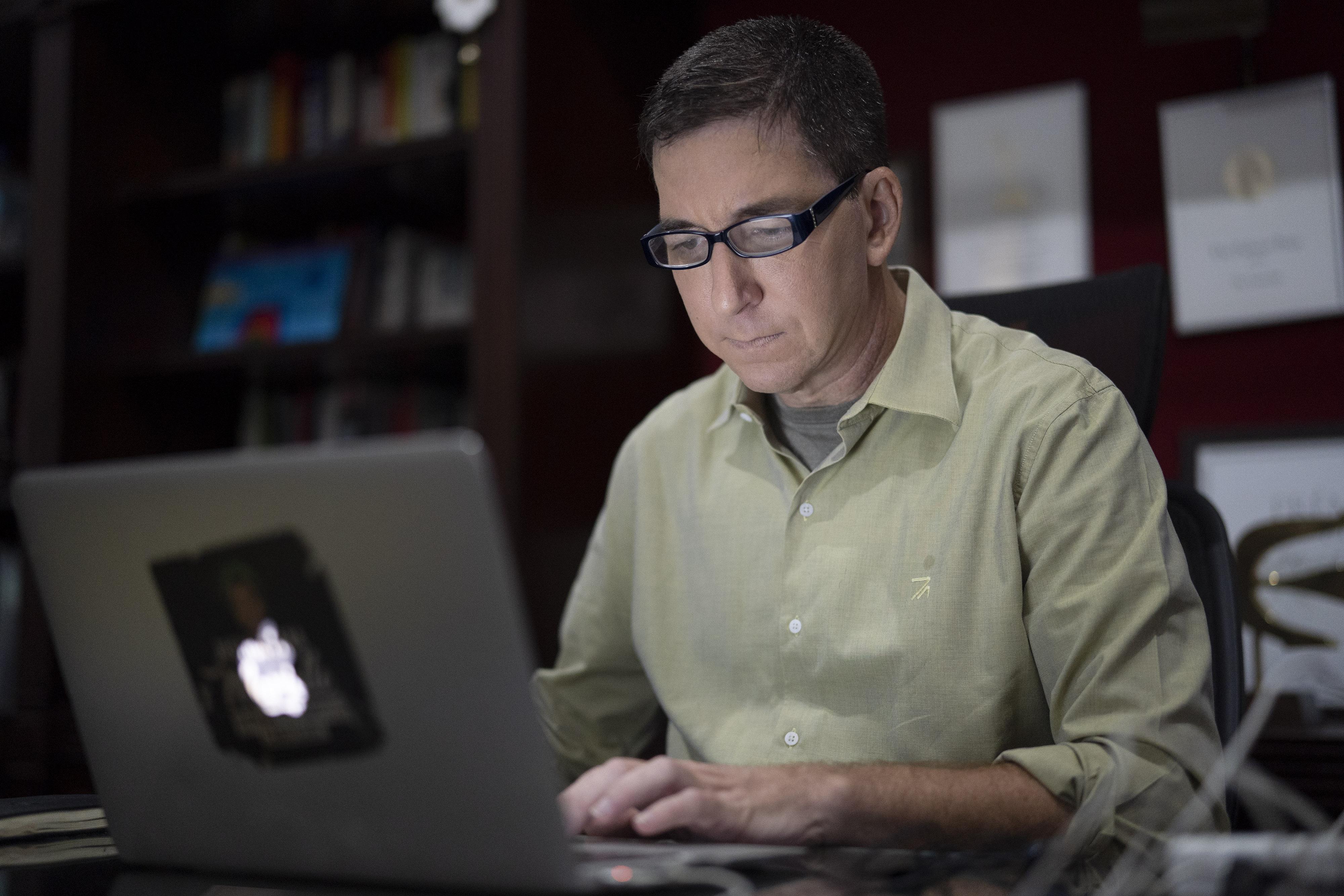 Brazil's president threatens to jail U.S. journalist Glenn Greenwald