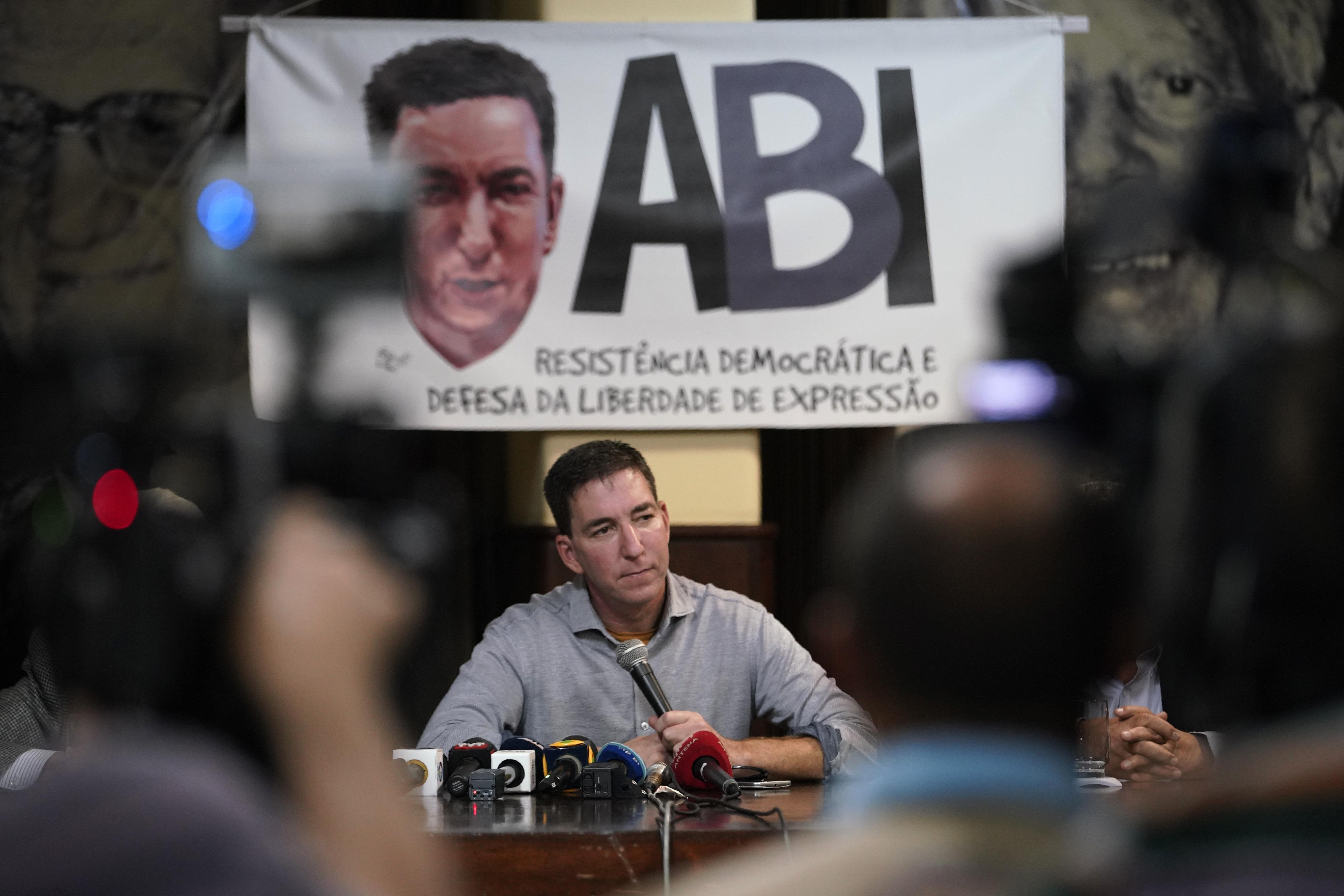 Brazilians rally around U.S. journalist Glenn Greenwald after president's jail threat