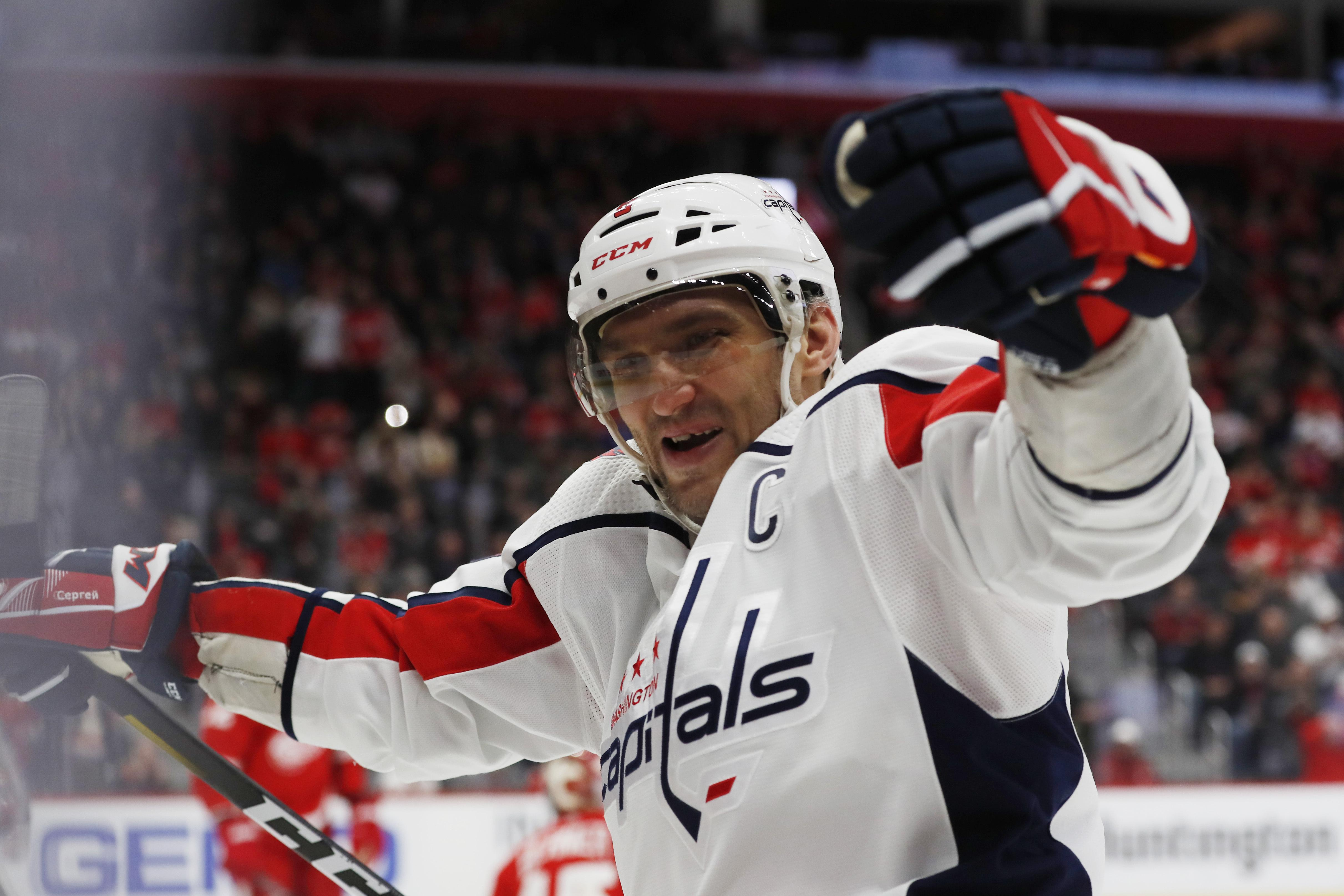 Alex Ovechkin gets hat trick with two empty-netters, Capitals top Red