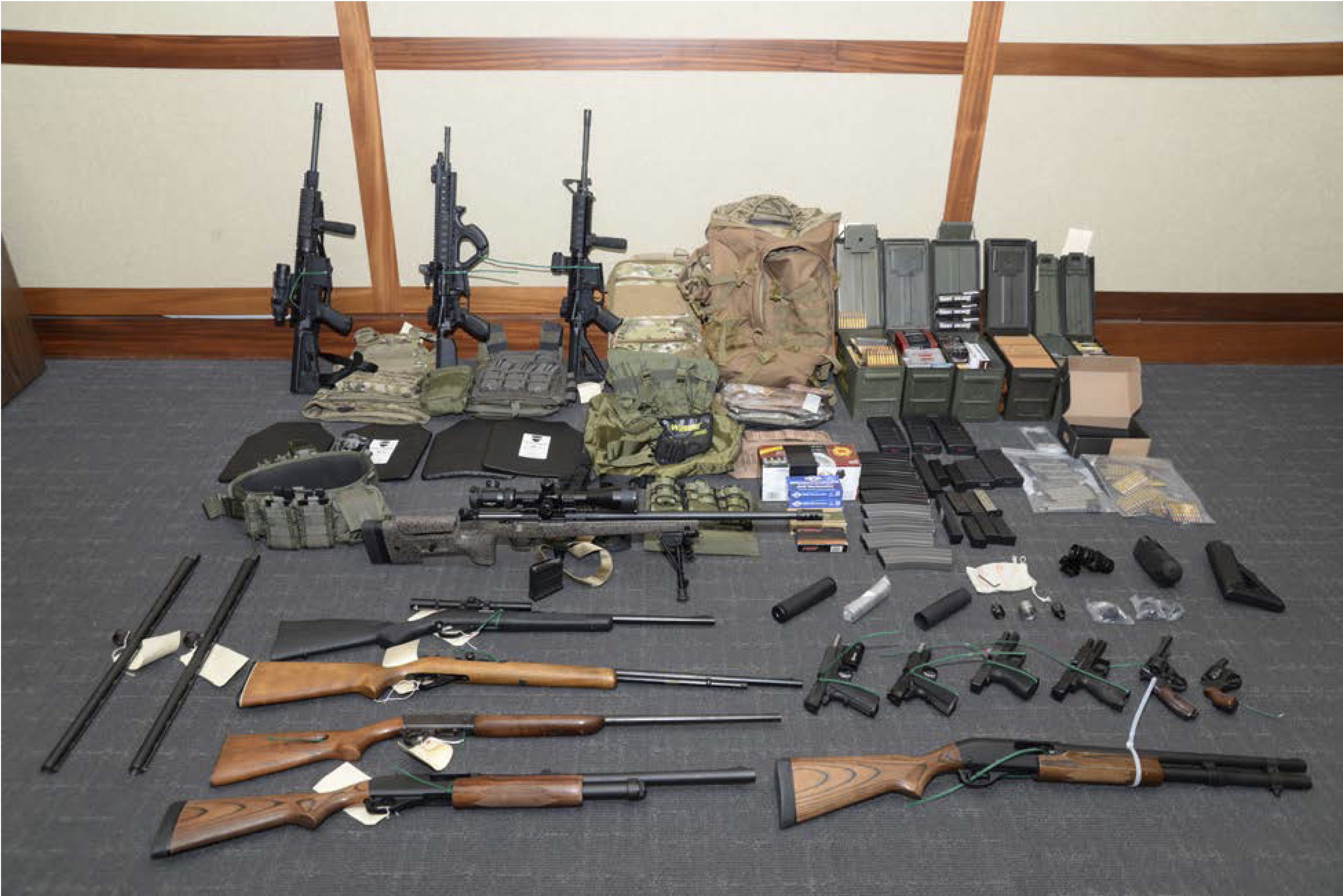 Feds seek to keep guns belonging to Coast Guard officer accused of tar